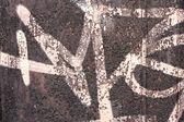 Graffiti on a wall - detail of a graffiti painted on a wall — Stock Photo