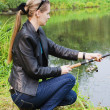 The beautiful young woman on fishing — Stock Photo