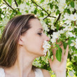 Stock Photo: Portrait of beautiful womwith apple tree flowers