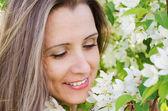 Portrait  woman with apple tree flowers  — Stock Photo