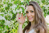 Portrait of beautiful  woman with apple tree flowers — Foto Stock