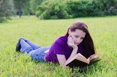 Woman  in a summer park — Stock Photo