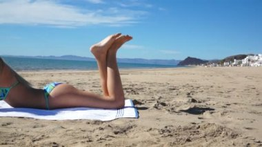 Beach Bikini Girl Lay Texting — Stock Video