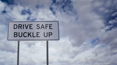 Sign Drive Safe Buckle Up Clouds Timelapse — Stock Video