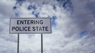 Entering Police State Sign Clouds Timelapse — Stock Video