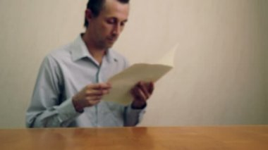 Male Reading and Throwing File Folder — Stock Video