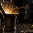 Stock Photo: Metal mortar with sparkling fire, surrounded with spices
