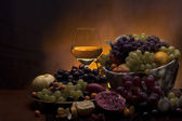Fruits with glass of white wine — Stock Photo