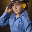 Boy with hat and flower — Stock Photo #22120789