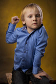 Boy threatens a fist — Stock Photo