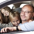 Huppy father with children in a car — 图库照片