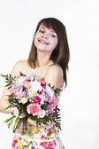 Smiling caucasian young woman with bouquet — Stock Photo