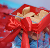 Sweet cookies in box with red bow — Stock Photo