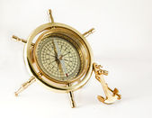 Golden old compass with anchor — Stock Photo