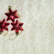 Foto de Stock  : Christmas red stars on the white background