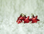 Christmas red stars on the white background — Stock Photo