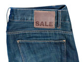 Jeans with Sale Sign — Photo