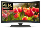 Curved 4K UHD Ultra High Definition TV on White Background — Стоковое фото