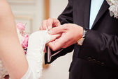 Groom putting a wedding ring on bride — Stock Photo