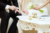 Bride and groom signing wedding documents. — Stock Photo