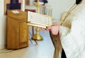 Priest in church — Stock Photo