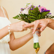 bride Put the Wedding Ring on groom — Photo