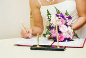 The bride signs the certificate — Stock Photo