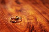 A pair of golden wedding rings layered on each other. — Stock Photo