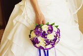 Wedding bouquet of flowers held by a bride. — Stock Photo