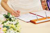 Bride signing marriage license or wedding contract — Foto Stock