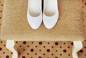 Beautiful white shoes from bride — Stock Photo