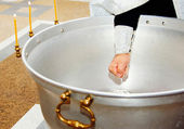 Close-up of hands with olive oil at orthodox christening — Stock Photo