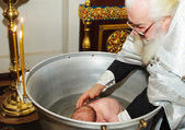 Ceremony of a baby christening — Stock Photo