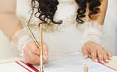 Bride signing  wedding contract — Stock Photo