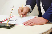 Groom sign wedding contract — Stock Photo