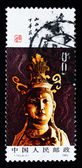A stamp printed in China shows the ancient buddha statue — Stok fotoğraf