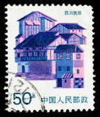 Stamp printed in China shows local dwelling in Sichuan — ストック写真
