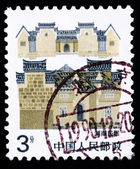 Stamp printed in China shows local dwelling in Hunan — Stock Photo