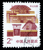 Stamp printed in China shows local dwelling in Northeast China — Stock Photo