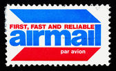 Stamp printed in US shows airmail — Stock Photo