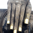 Stock Photo: Statue of Buddha's hand in Historical Park of Sukhothai