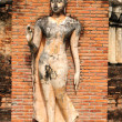 Stock Photo: Statue of deity in Historical Park of Sukhothai