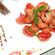 Stir-fried flowering Chinese chives with prawns and carrot — Stock Photo