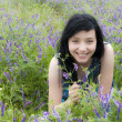 Black Hair Girl in Blue Flowers — Stock Photo