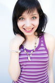 Beautiful Brunette Girl with Purple Camisole — Stock Photo