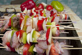 Skewers with fish and vegetables — Stock Photo