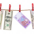 American and Ukrainian currencies is dry on the rope. — Stock Photo #5602713