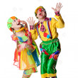 Two cheerful clowns in the soap bubbles — Stock Photo