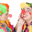 Stock Photo: Couple of happy clowns