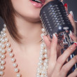 Young singer with a retro microphone — Stock Photo